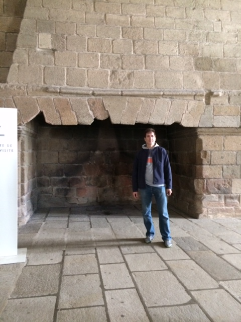 "I guess you would need spectacular fires to keep the abbey warm. My husband is 6'2"", to give you a sense of how big the hearth is."